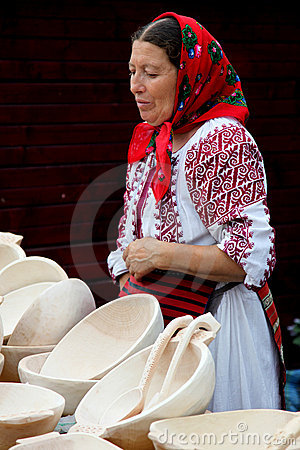 Woman selling wood plates at a traditional fair Editorial Photography