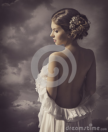 Woman fashion dress, retro hair style, naked back, historical romance portrait Stock Photo