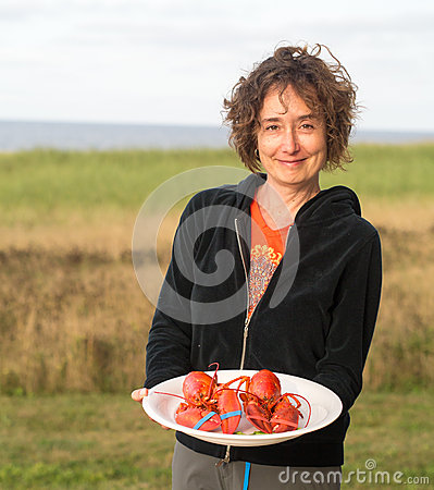 Woman serving lobster at beach