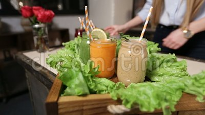 Woman serving tray with colorful smoothies stock video footage