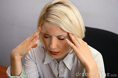 Woman with severe Headache (Migraine)