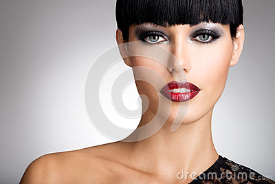Woman with  sexy red lips and fashion color eye makeup