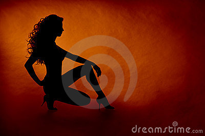 Woman sexy silhouette over orange background