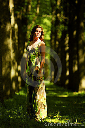 Woman on a shady park alley