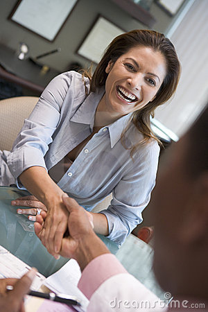 Woman shaking doctor s hand at IVF clinic