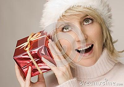 Woman shaking gift