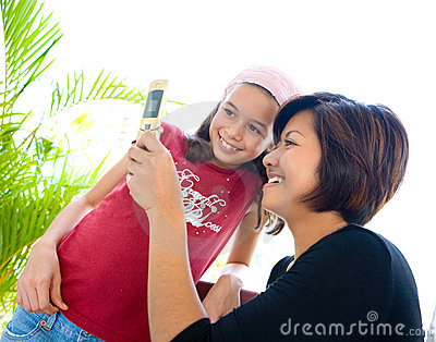 Woman sharing information on her cell phone