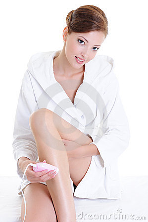 Free Woman Shaving Legs With Electric Shaver Stock Image - 10812641