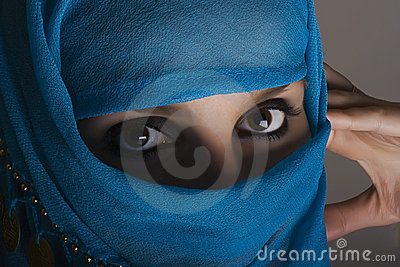 Woman with shawl on face