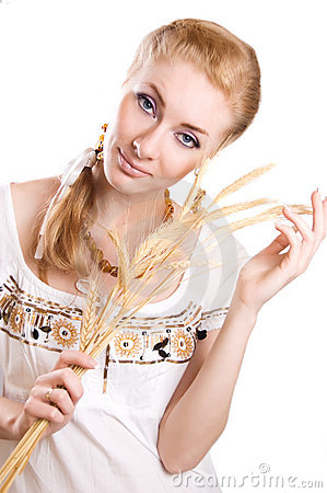 Woman with sheaf of wheat