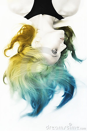 Woman with shiny silver makeup and colorful hair