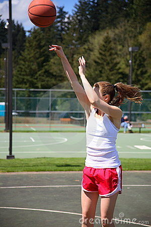 Woman shooting basketball