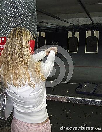 Woman shooting a gun