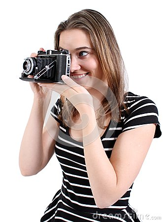 Woman shooting a vintage camera