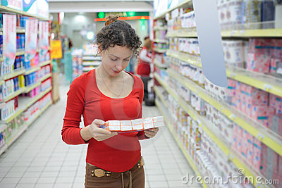 Woman in shop of household hygiene