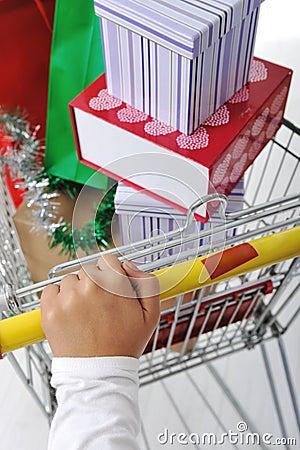 Woman in shoping pushing cart