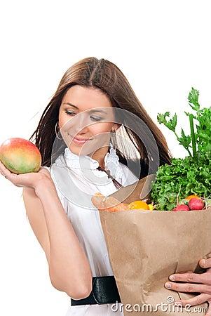 Woman shopping bag full of vegetarian groceries
