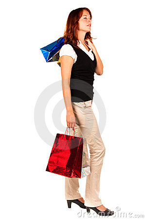 Woman shopping, bags high. Looking to the side