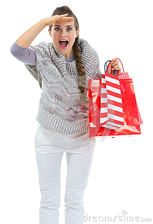 Woman with shopping bags looking into distance