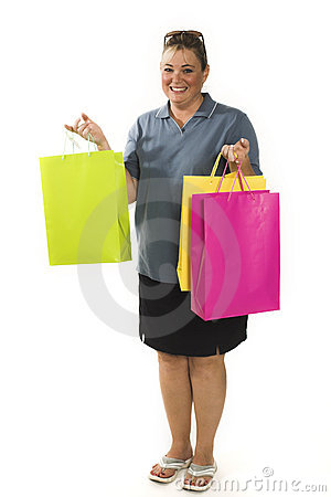 Woman with shopping bags posing