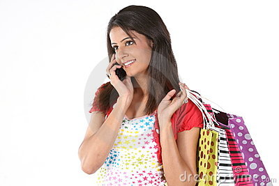 Woman with shopping bags and talking on the cell p