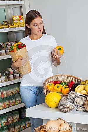 Woman Shopping Bellpeppers In Supermarket