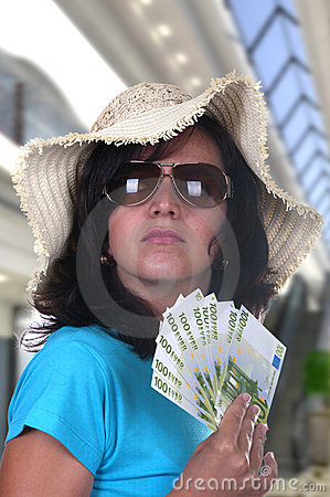 Woman shopping with bills of 100 euros
