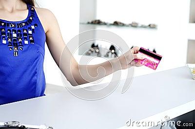 Woman at shopping checkout paying credit card