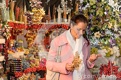 Woman shopping Christmas decorations festive mood