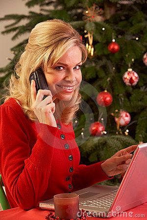 Woman Shopping Online For Christmas Gifts On Phone