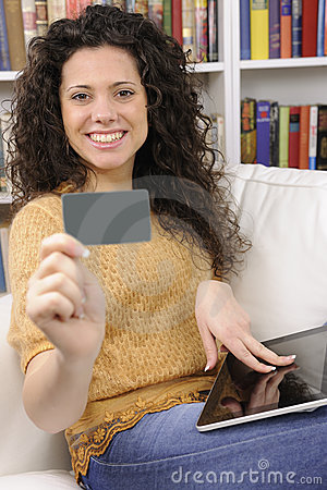 Woman shopping online with credit or gift card