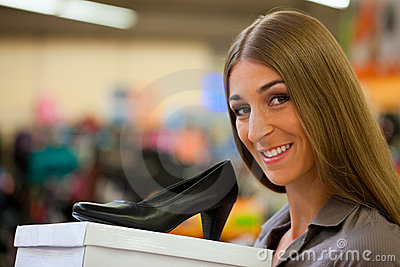 Woman shopping shoes in store