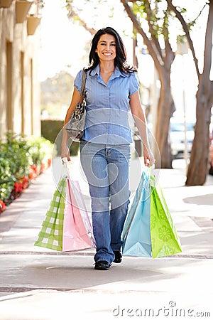 Woman Shopping walking down the street