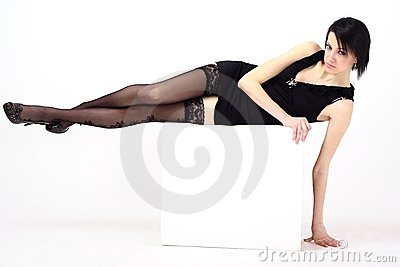 Woman in short dress lies on a white background