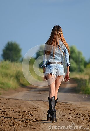 The woman in shorts on road
