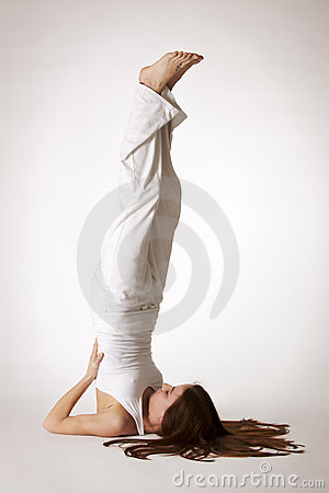 Woman in shoulder stand Yoga posture (Sarvangasana