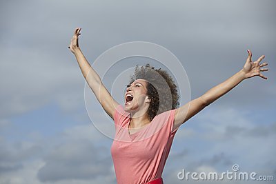 Woman shouting with arms outstretched