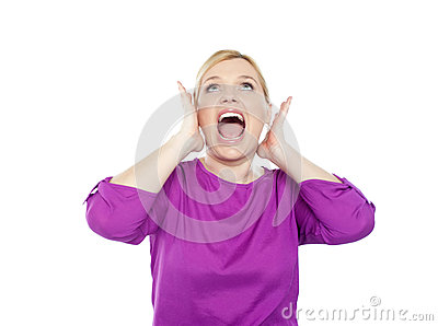 Woman shouting with hands on ears