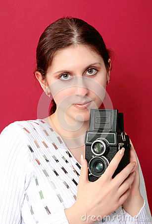 Woman shouting holding a camera