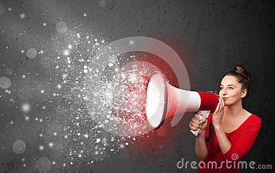 Woman shouting into megaphone and glowing energy particles explo