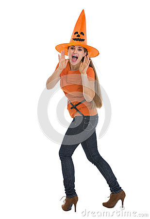 Woman shouting through megaphone shaped hands