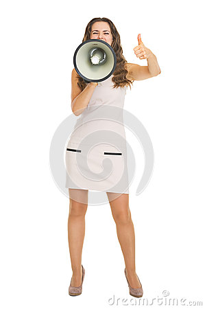 Woman shouting through megaphone and showing thumbs up