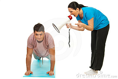 Woman shouting by megapone to workout man