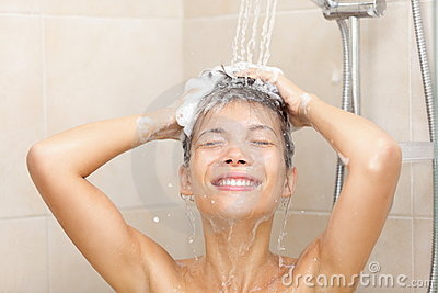 Woman in shower washing hair