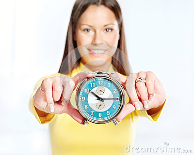 Woman showing alarm clock