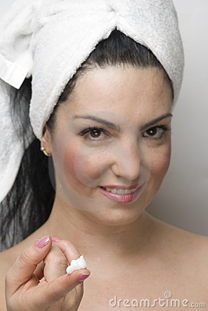 Woman showing cream for skin care