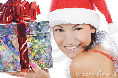Woman showing gift wearing Santa hat.