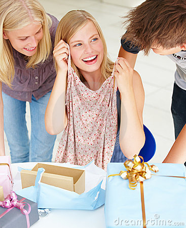 Woman showing gifts to her friends