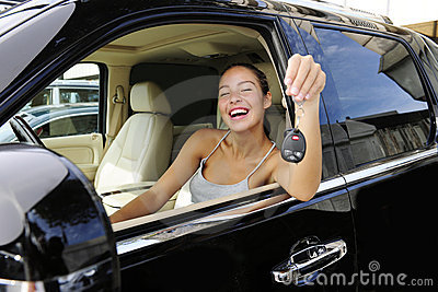 Woman showing keys of her new 4x4 off-road vehicle