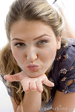 Woman showing kissing gesture